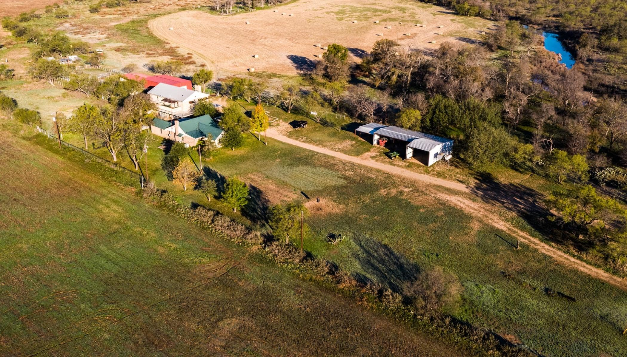 aerial view of ranch managers and headquarters houses near barns on triple draw ranch