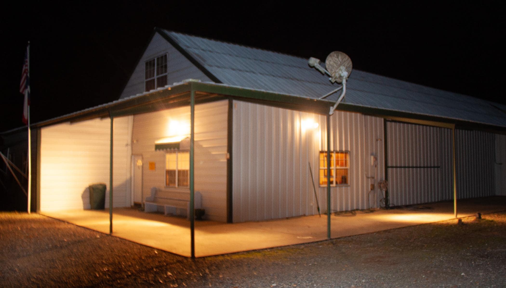 barn and covered porch at night at rancho de patos