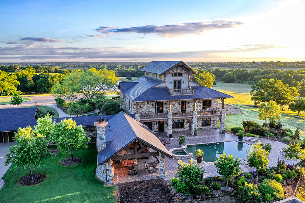 aerial view of main house porch and pool at sugar ridge ranch