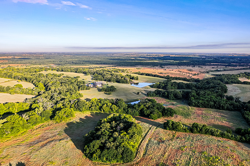 aerial view of rolling fields and forest at sugar ridge ranch