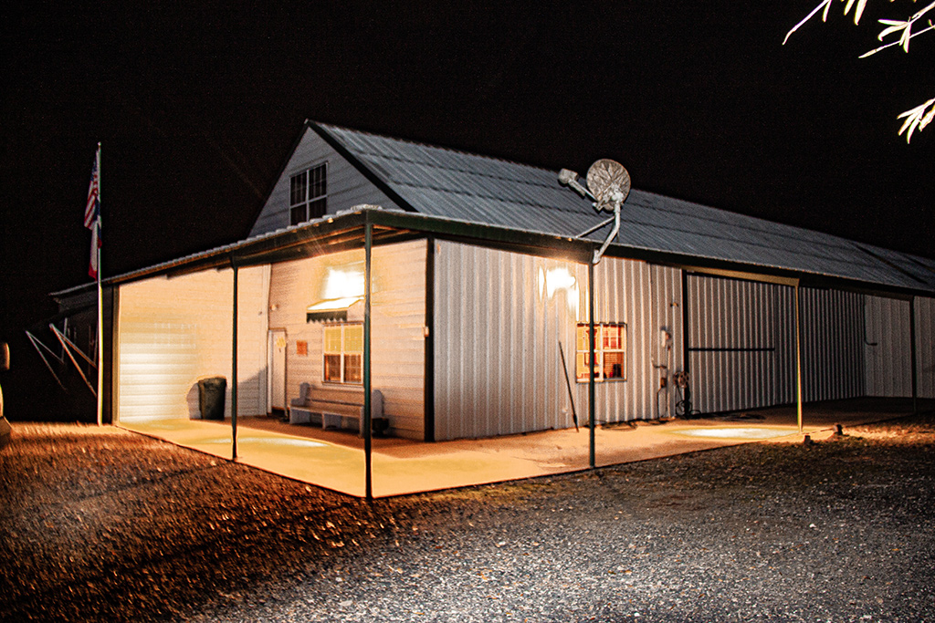 barn and covered porch at night at rancho de patos